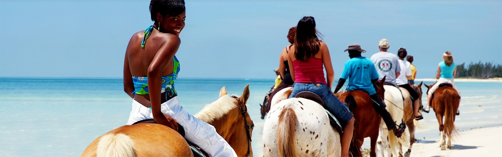 Horseback riding on a beach